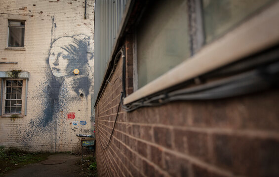 Bristol, United Kingdom, 21st February 2019, Girl with a Pierced Eardrum by Banksy