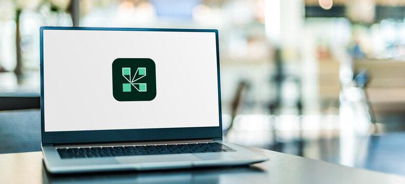 Laptop computer displaying logo of Adobe Connect
