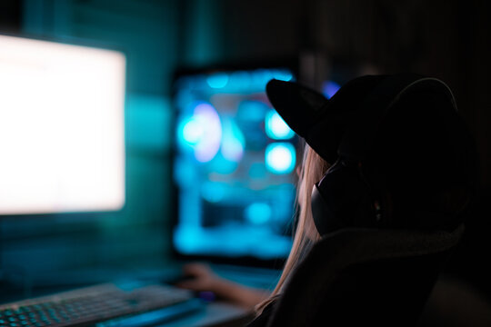 Gamer girl playing on the computer, at home.