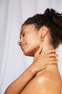 Woman applying lotion to her neck