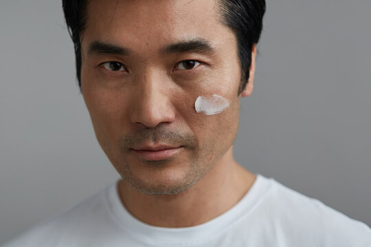 Studio portrait asian man skin care