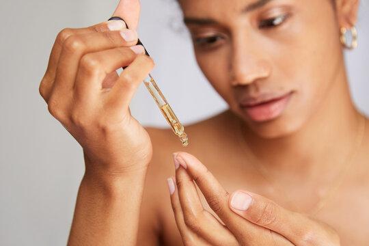 Woman using hyaluronic acid dropper