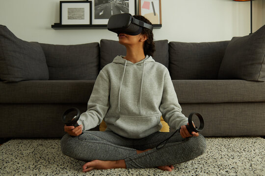 Woman doing Yoga in VR