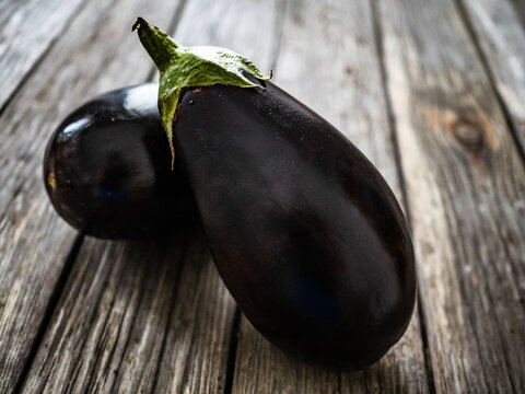 Ripe aubergine on wooden table