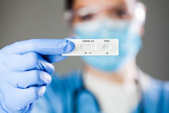 COVID-19 virus disease diagnostic,doctor holding Coronavirus test cassette,rapid strep (RST) kit,quick antigen detection testing (RADT),patient fast swab antibody specimen sample illustration concept