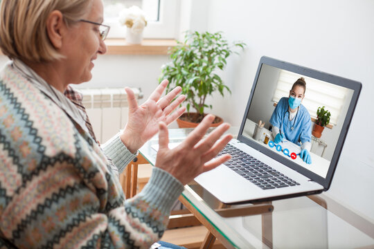 Elderly caucasian woman interacting with young female doctor via video call,medical worker seeing patient in a virtual house call,telemedicine during pandemic and on demand medical service concept