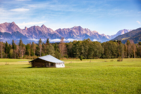 Little shed in front of the alps
