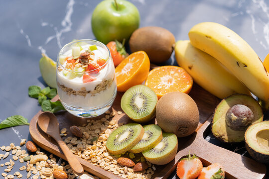 Plain yogurt with fresh fruits and granola on top in glass.Healthy food