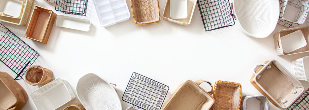 Top view of closet organization boxes and steel wire baskets in different shapes.