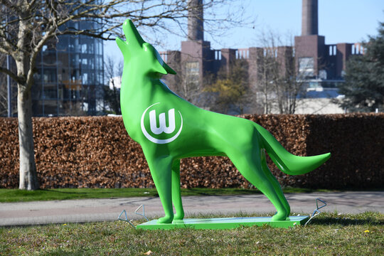 Wolfsburg, Lower Saxony / Germany - April 6, 2020: Howling wolf with the logo of German football club VfL Wolfsburg in Wolfsburg, Germany
