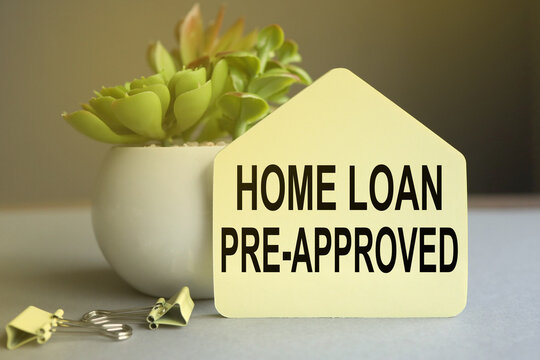 Home loan pre-approval, text on a sticker in the form of a house on a gray background