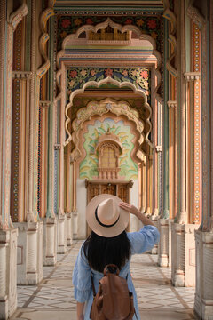 "Woman tourist is traveling and sightseeing at Patrika Gate in the Jawahar Circle Gardens in the ""Pink City"" , Jaipur, Rajasthan, India."