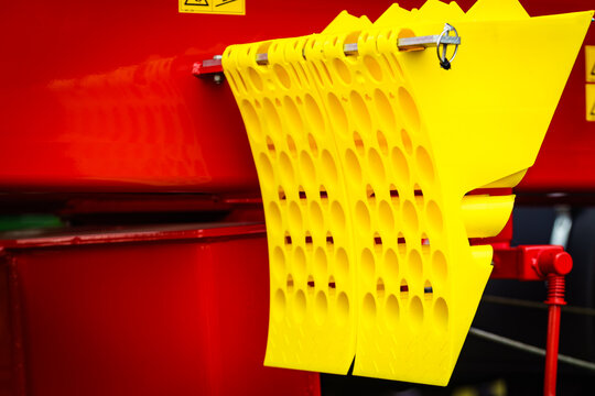 Yellow brake stop blocks wedges on red tractor