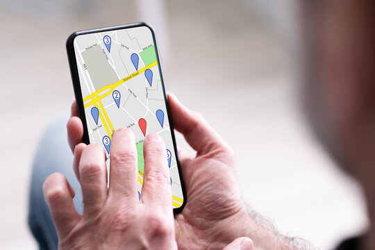 Person's Hand Using GPS Navigation Map