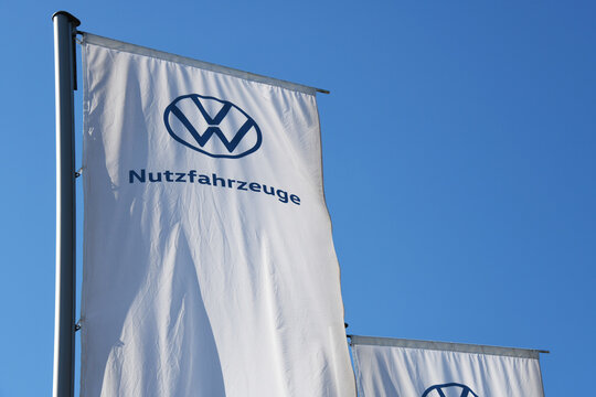 Wolfsburg, Lower Saxony / Germany - April 6, 2020: Flag with the logo of Volkswagen Nutzfahrzeuge in Wolfsburg - Volkswagen Commercial Vehicles - VWCV - is a German marque of light commercial vehicles