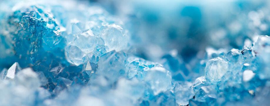 Blue Crystals. Macro. Winter Backgroun.Beautiful Light. Banner format.