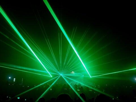 Green Illuminated Light Beams In Darkroom