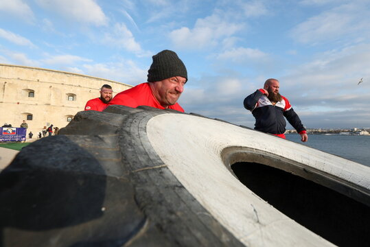 "Athletes take part in a strongmen contest ""People are stronger than machines"" in Sevastopol"
