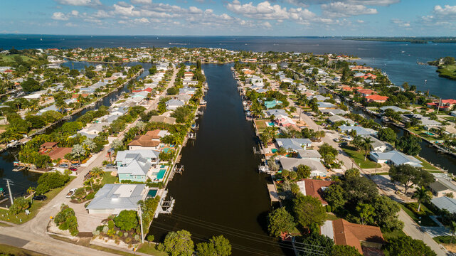 """Anna Maria Island, FL / USA - 11-14-2020: Drone view of the luxurious Intracoastal waterfront homes on Anna Maria Island."""