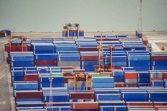 Stack Of Pier With Cargo Container Against Blue Sky