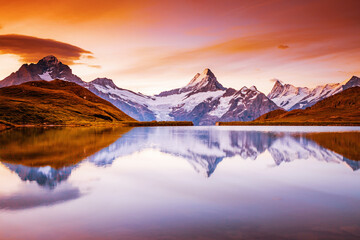 Wall Mural - The majestic peaks in sunlight. Location place Bachalpsee, Swiss alps, Switzerland, Grindelwald valley.