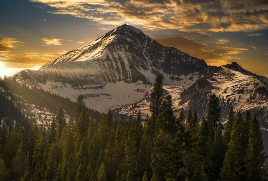 This image shows an epic winter mountainous landscape at Lone Peak in Big Sky, Montana.