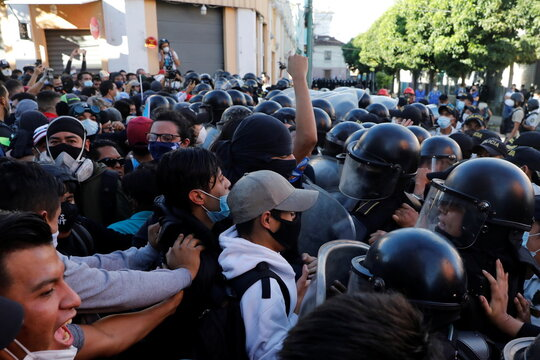 Riot police clash with demonstrators taking part in a protest demanding the resignation of President Alejandro Giammattei, in Guatemala City