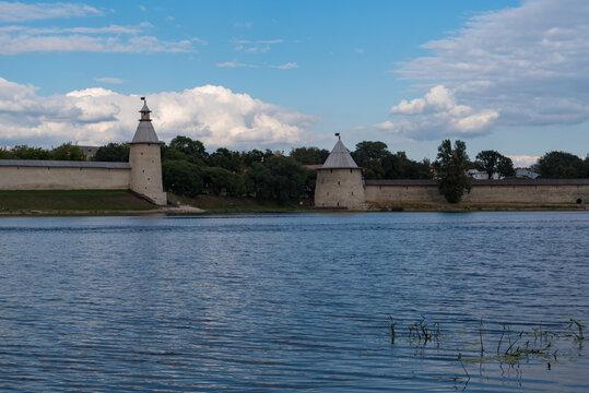 The High and The Flat tower in Pskov Krom (Kremlin). River Pskova creek. Russia