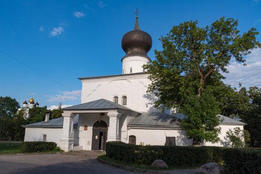 Assumption church from Paromenya (Uspenskaya church, XVI century) and its bell tower. Pskov city, Pskov Region (Pskovskaya oblast), Russia.