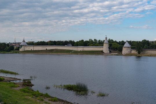 Varlaam, The High and The Flat tower in Pskov Krom (Kremlin). River Pskova creek. Russia