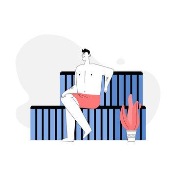 Man sitting on bench in steam room, bathing in sauna