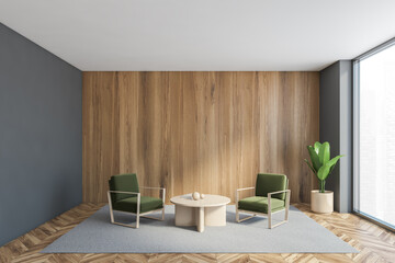 Two green armchairs with coffee table in grey and wooden hall with window