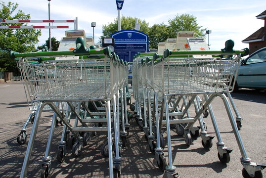 Shopping trollies outside a branch of supermarket chain Waitrose at Tenterden in Kent, England on June 27, 2008.