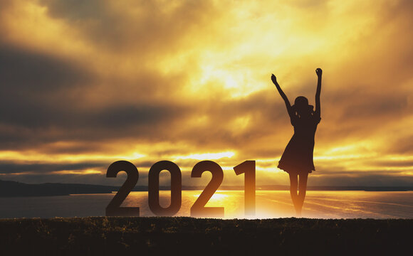 New year 2021 traveler woman with sunset sky background