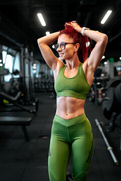 Active woman doing workout and legs workout at gym.