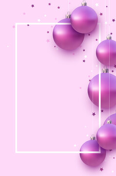 Vertical frame with pink christmas tree balls hanging on strings.