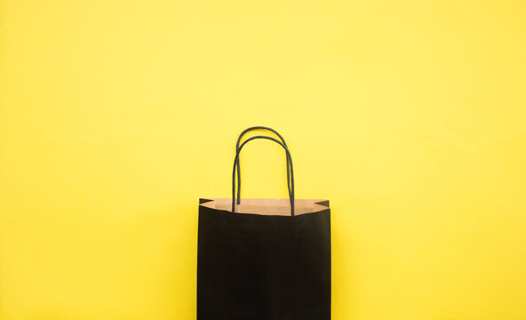 Black friday festival concepts with shopping bag on yellow background