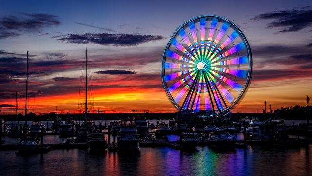 Illuminated Capital Wheel ferris ride at National Harbor near Washington DC at sunset