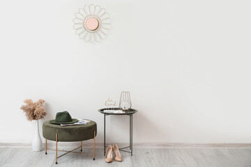 Stylish interior of modern hall with table and pouf