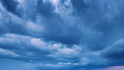 Fotobehang - Dramatic storm clouds moving in dusk sky. Timelapse, 4K UHD.
