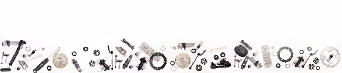 Fototapeta Bicycle parts on a white background.