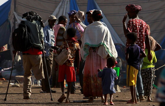Ethiopians who fled the ongoing fighting in Tigray region, arrive in Hamdayet village near the Sudan-Ethiopia border, eastern Kassala state