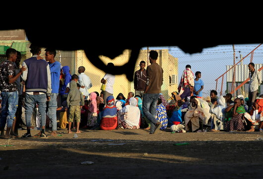Ethiopians who fled the ongoing fighting in Tigray region, gather in Hamdayet village near the Sudan-Ethiopia border, eastern Kassala state
