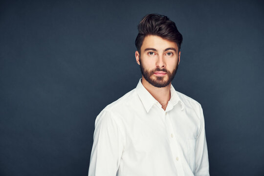 Portrait of handsome man isolated on dark blue background