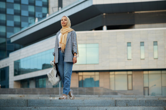 Arab female student at the building in downtown