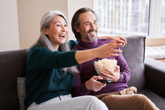 Couple laughing and watching tv show
