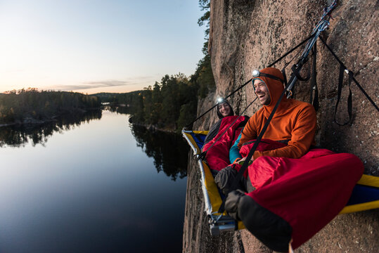 Two hikers resting in portaledge, Sweden