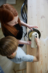 Children using electric mixer, Sweden