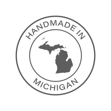 """""""Handmade in Michigan"""" icon, vector with transparency. With state silhouette in the middle."""