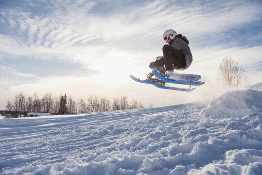 Boy on ski sledge, Sweden